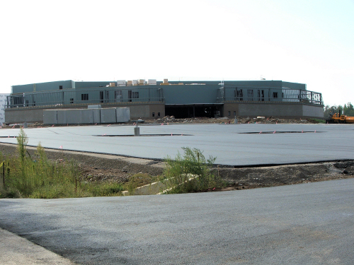 Looking at new indoor arena across new parking lot.  Picture taken from the highway side.